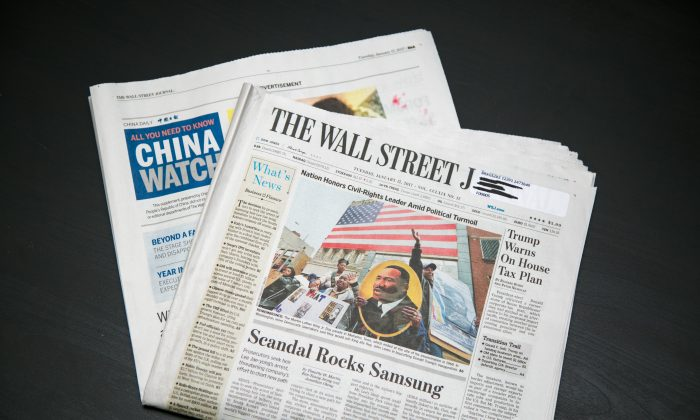 A paid insert of China Daily inside the Jan. 17, 2017 edition of the Wall Street Journal, carried a propaganda piece attacking Shen Yun Performing Arts, a classical Chinese dance company based in New York. (Benjamin Chasteen/Epoch Times)