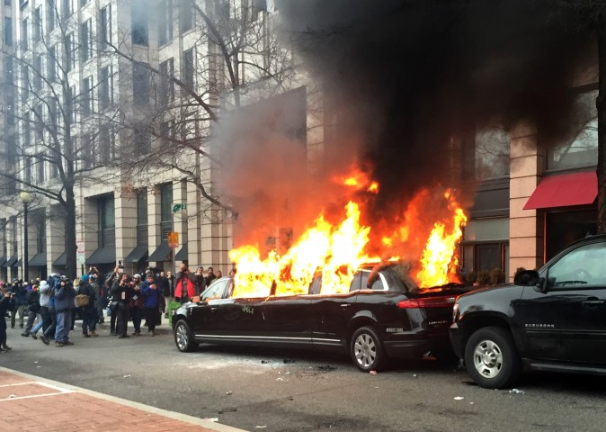Protesters set a parked limousine on fire in downtown Washington on Jan. 20, 2017, during the inauguration of President Donald Trump. (AP Photo/Juliet Linderman)