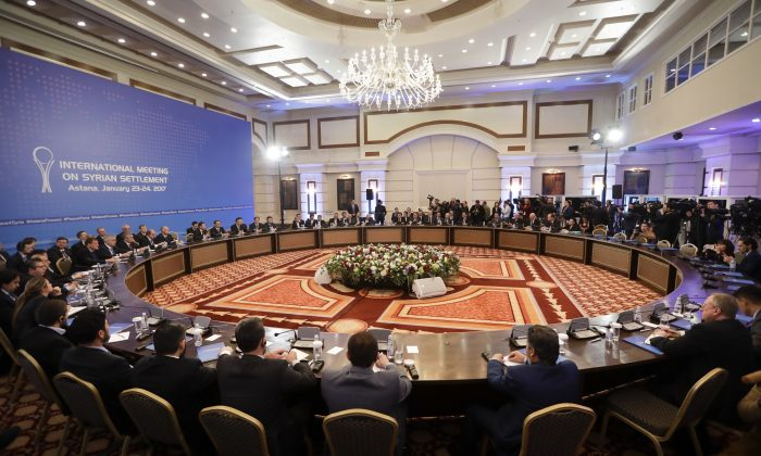 Delegations of Russia, Iran and Turkey hold talks on Syrian peace at a hotel in Astana, Kazakhstan, Monday, Jan. 23, 2017. The talks are the latest attempt to forge a political settlement to end a war that has by most estimates killed more than 400,000 people since March 2011 and displaced more than half the country's population. (AP Photo/Sergei Grits)
