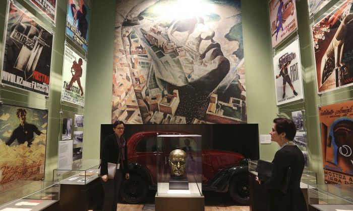 A  woman  looks at an exhibit in the Museum of the Second World War, an ambitious new museum under creation for nine years has opened its doors for a day to historians, museums and reporters in Gdansk, Poland, on Jan. 23, 2017.  (AP Photo/Czarek Sokolowski)