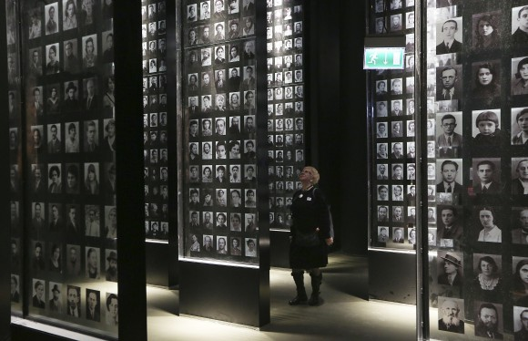 A  visitor  looks at an exhibit in the Museum of the Second World War, an ambitious new museum under creation for nine years has opened its doors for a day to historians, museums and reporters in Gdansk, Poland, on Jan. 23, 2017.  (AP Photo/Czarek Sokolowski)