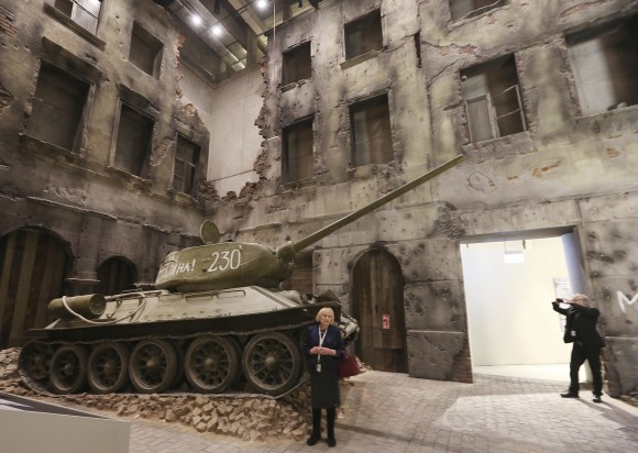 A woman stands in front of an exhibit in the Museum of the Second World War, an ambitious new museum under creation for nine years has opened its doors for a day to historians, museums and reporters in Gdansk, Poland, on Jan. 23, 2017.  (AP Photo/Czarek Sokolowski)