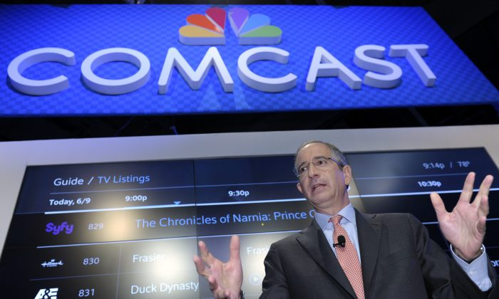 In this file photo, Comcast Corp. CEO Brian Roberts speaks during The Cable Show 2013 convention in Washington, on June 11, 2013. (AP Photo/Susan Walsh, File)