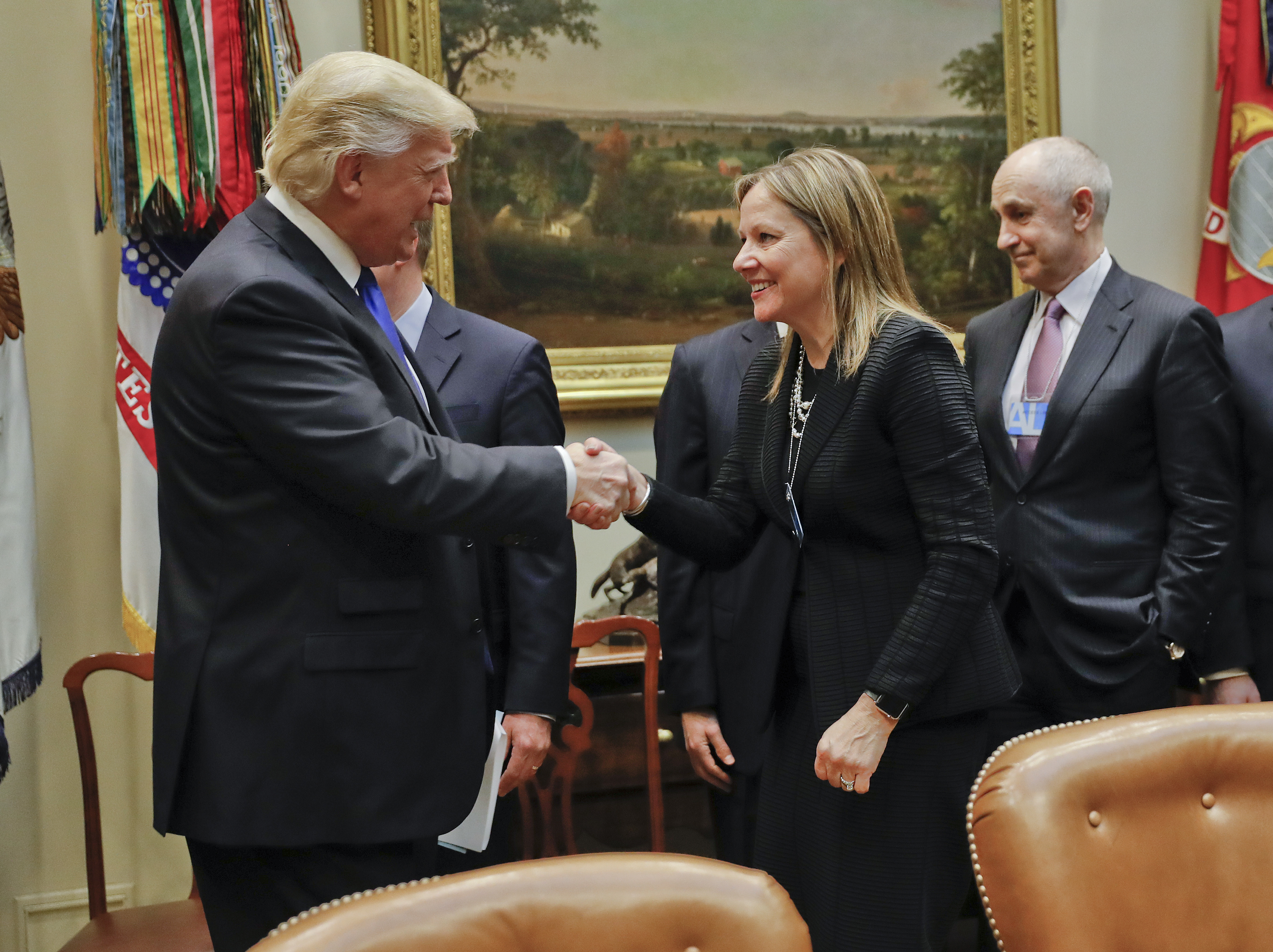 President Donald Trump greets GM CEO Mary Barra as he hosts a breakfast with automobile leaders in the Roosevelt Room of the White House in Washington on Jan. 24, 2017. (AP Photo/Pablo Martinez Monsivais)