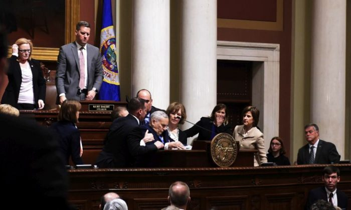 Minnesota Gov. Mark Dayton collapses while giving his annual State of the State address at the state Capitol in St. Paul, Minn., Monday, Jan. 23, 2017.  The 69-year-old Democrat was helped into a back room and appeared to be conscious. (Scott Takushi/Pioneer Press via AP)