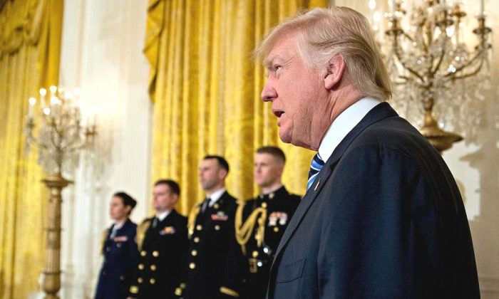 President Donald Trump arrives to a swearing in ceremony of White House senior staff in the East Room of the White House in Washington, DC. on Jan. 22, 2017. (Andrew Harrer-Pool/Getty Images)