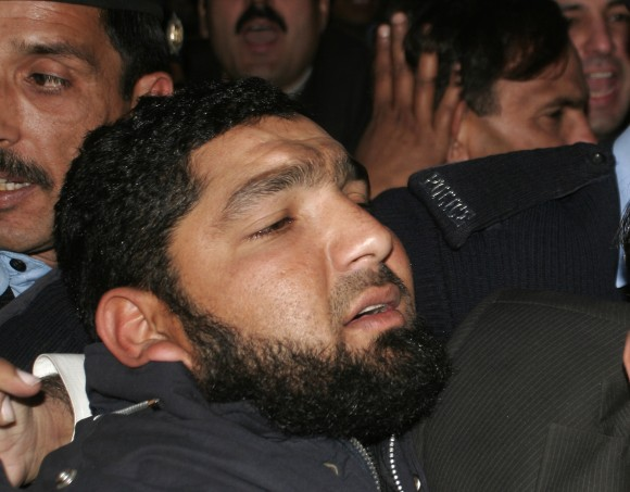 Mumtaz Qadri, who was hanged for killing a Pakistani politician who criticized Pakistan's controversial blasphemy law and defended a Christian woman, arrives at a court in Islamabad, Pakistan in this Jan 5, 2011 file photo. (AP Photo/B.K. Bangash)