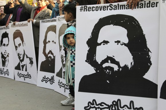 Activists from Pakistan's civil society demand recovery of missing persons, in Lahore, Pakistan on Jan. 12, 2017. Pakistan's controversial blasphemy law which demands death to anyone accused of insulting Islam or its prophet has been a rallying cry for extremist groups who threaten violence at any attempt to prevent abuses, never mind repeal it. (AP Photo/K.M. Chaudhry)