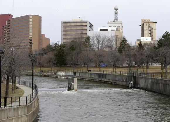 FILE - This Feb. 5, 2016, file photo, shows the Flint River in Flint, Mich. Michigan environmental officials announced Tuesday, Jan. 24, 2017, that Flint's water system no longer has levels of lead exceeding the federal limit. The finding by the Department of Environmental Quality is good news for a city whose 100,000 residents have grappled with the man-made water crisis since 2014. (AP Photo/Carlos Osorio, File)