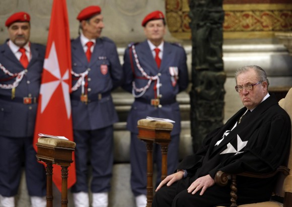 Grand Master of the Knights of Malta Matthew Festing waits for the start of a Mass celebrated by Cardinal Tacisio Bertone, not pictured, to mark the 900th anniversary of the Order of the Knights of Malta, at the Vatican in this Feb. 9, 2013 file photo. (AP Photo/Gregorio Borgia, File)