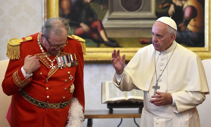 Pope Francis delivers his blessing during his meeting with Grand Master of the Knights of Malta Matthew Festing, left, at the Vatican in this June 23, 2016 file photo. On Wednesday, Jan. 25, 2017 the Vatican said Pope Francis will name a pontifical delegate to run the embattled Knights of Malta, effectively taking over the sovereign lay Catholic order after its leader Festing resigned in a bitter dispute with the pontiff over condoms. ( Gabriel Bouys/ Pool Photo via AP, files)
