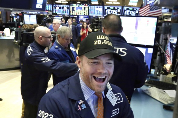 Specialist Frank Masiello wears a Dow 20,000 cap as he works on the floor of the New York Stock Exchange on Jan. 25, 2017. The Dow Jones industrial average is trading over 20,000 points for the first time, the latest milestone in a record-setting drive for the stock market. (AP Photo/Richard Drew)
