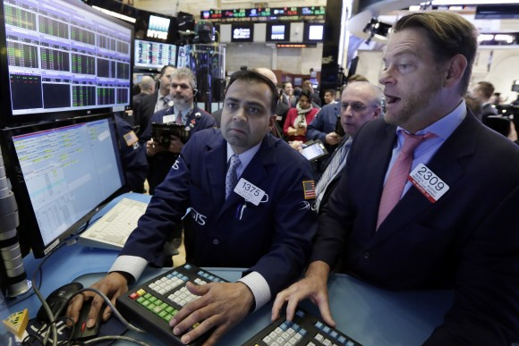 Specialists Dilip Patel, left, and Patrick Murphy work on the floor of the New York Stock Exchange on Jan. 25, 2017. The market has been marching steadily higher since bottoming out in March 2009 in the aftermath of the financial crisis. (AP Photo/Richard Drew)