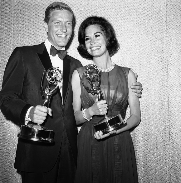 "Dick Van Dyke, left, and Mary Tyler Moore, co-stars of ""The Dick Van Dyke Show"" backstage at the Palladium with their Emmys for best actor and actress in a series at the Television Academy's 16th annual awards show, in Los Angeles on May 25, 1964. (AP Photo, File)"