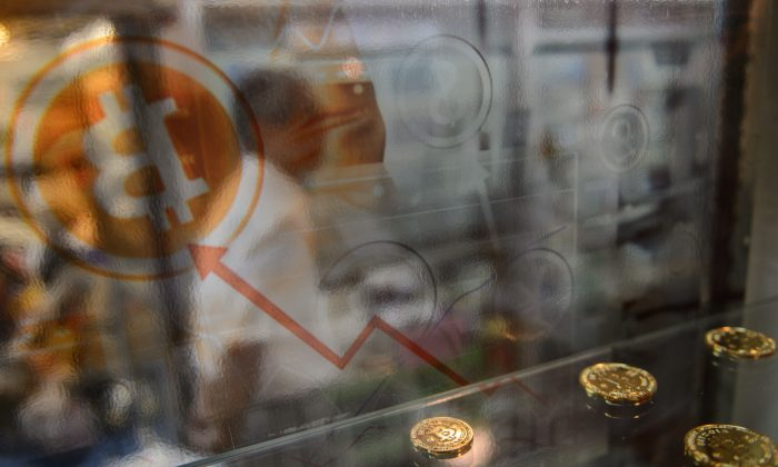 A Bitcoin display at a store window in Hong Kong on Aug. 13, 2016.  (Anthony Wallace/AFP/Getty Images)