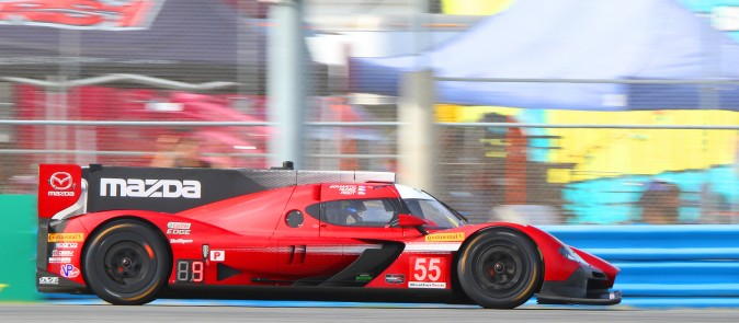 Tristan Nunez drives the #55 Mazda in the Thursday afternoon practice session for the Rolex 24. (Chris Jasurek/Epoch Times)