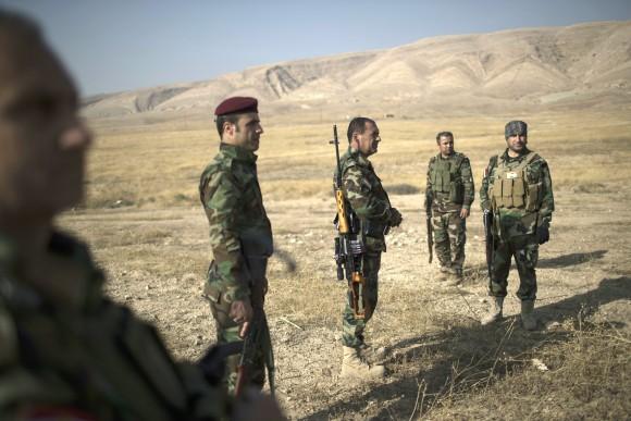 Kurdish Peshmerga fighters gather near a frontline during fighting with ISIS terrorists in Bashiqa, east of Mosul, Iraq, on Nov. 8. (AP Photo/Felipe Dana)
