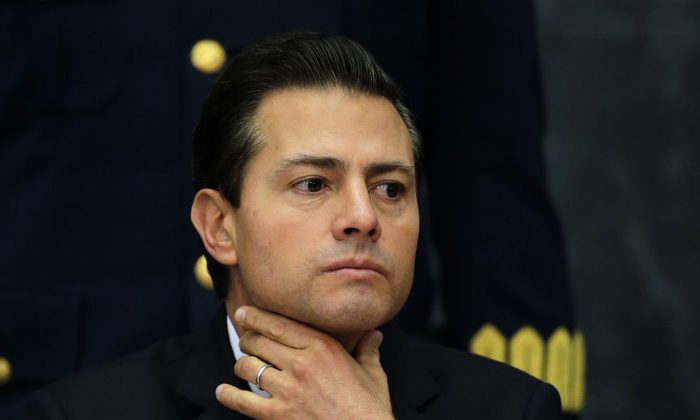 Mexico's President Enrique Pena Nieto during a press conference at Los Pinos presidential residence in Mexico City, on Jan. 23, 2017. (AP Photo/Marco Ugarte)
