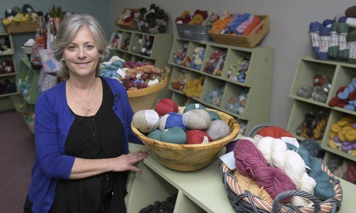 Elizabeth Poe poses in her store, The Joy of Knitting in Franklin, Tenn., on Jan. 25, 2017. (Shelley Mays/The Tennessean via AP)