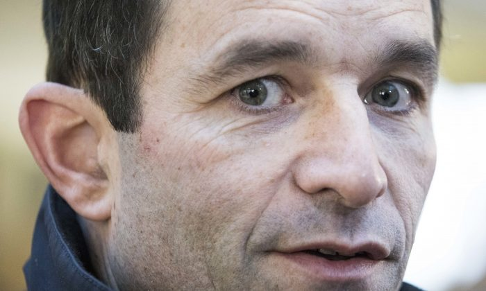 Candidate for the French left's presidential primaries ahead of the 2017 presidential election, Benoit Hamon, speaks to the media after the first round of the primaries in Trappes, west of Paris, France on Jan. 22, 2017. (AP Photo/Kamil Zihnioglu, File)