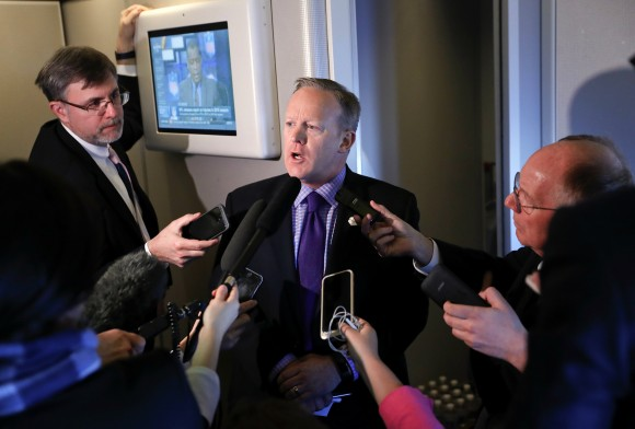"""White House press secretary Sean Spicer speaks to reporters on Air Force One en route to Andrews Air Force Base from Philadelphia on Jan. 26, 2017. Spicer says that taxing imports from Mexico would generate $10 billions a year and """"easily pay for the wall."""" (AP Photo/Pablo Martinez Monsivais)"""