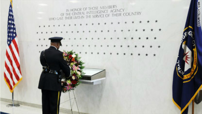An honor guard lays a wreath at the CIA Memorial Wall of stars for those killed serving their country. (Courtesy CIA)