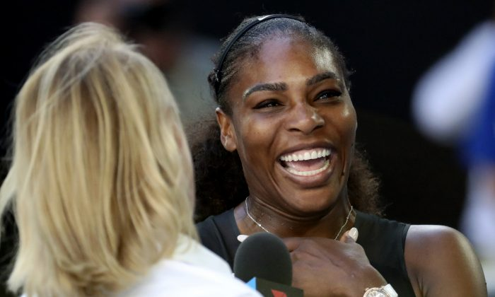 United States' Serena Williams laughs as she is interviewed on court following her semifinal win over Croatia's Mirjana Lucic-Baroni at the Australian Open tennis championships in Melbourne, Australia on Jan. 26, 2017. (AP Photo/Aaron Favila)