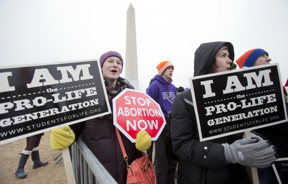 "Michelle Doyle, left, joins the March for Life 2016 rally, commemorating the anniversary of 1973 ""Roe v. Wade"" U.S. Supreme Court decision legalizing abortion in Washington on Jan. 22, 2016. The annual rally will be held Friday on the National Mall in the nation's capital on Jan. 27, 2017. (AP Photo/Manuel Balce Ceneta, File)"