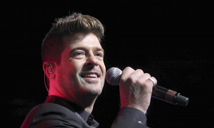Robin Thicke performs during the Steve Harvey Morning Show live broadcast at the Georgia World Congress Center in Atlanta, in this file photo. (Robb D. Cohen/Invision/AP)