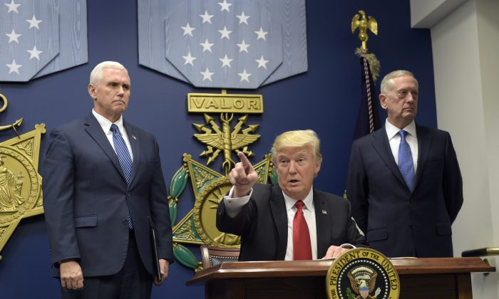 President Donald Trump (C) gestures after signing two executive action with Vice President Mike Pence (L) and Defense Secretary James Mattis at his side at the Pentagon in Washington on Jan. 27, 2017. (AP Photo/Susan Walsh)
