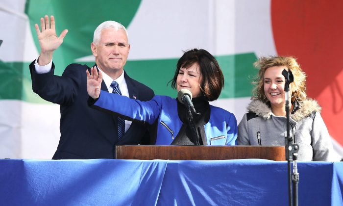 (L-R) U.S. Vice President Mike Pence, his wife Karen Pence and their daughter Charlotte Pence arrive for a rally on the National Mall before the start of the 43rd annual March for Life Jan. 27, 2017 in Washington, DC. The march is a gathering and protest against the United States Supreme Court's 1973 Roe v. Wade decision legalizing abortion. (Chip Somodevilla/Getty Images)