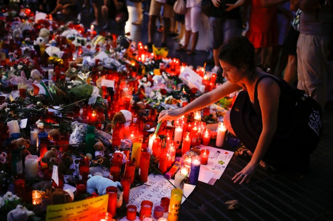 People display flowers, messages and candles to pay tribute to the victims of the Barcelona and Cambrils attacks on the Rambla boulevard in Barcelona on Aug. 22. (PAU BARRENA/AFP/Getty Images)