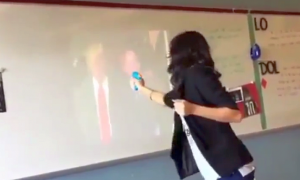 Dallas Teacher Suspended After Video Shows Her Shooting Squirt Gun at Trump
