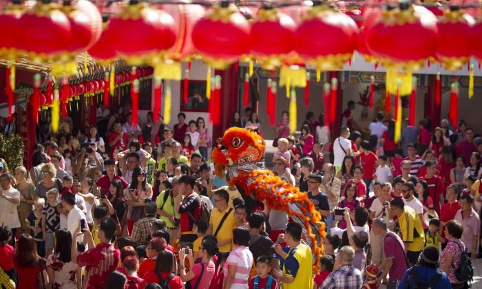Lion dance troupe performs during the first day of Chinese Lunar New Year at a temple in Kuala Lumpur, Malaysia, on Saturday, Jan. 28, 2017. The celebration marks the Year of the Rooster in the Chinese calendar. (AP Photo/Lim Huey Teng)