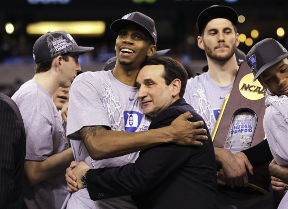 Duke coach Mike Krzyzewski and guard Lance Thomas embrace after Duke's 61-59 win over Butler in the men's NCAA Final Four championship game in Indianapolis on April 5, 2010. One of the all-time upsets nearly came to be when Gordon Hayward's heave from half court hit the backboard and the front rim before bouncing out at the buzzer to give the Blue Devils a 61-59 victory. (AP Photo/Michael Conroy, File)