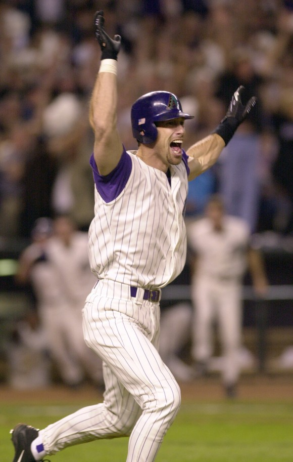 Arizona Diamondbacks' Luis Gonzalez celebrates driving in the winning run in the ninth inning of Game 7 of the baseball World Series against the New York Yankees in Phoenix on Nov. 4, 2001. Less than two months after the terrorist attacks knocked down the World Trade Center towers, the New York Yankees had the country behind them for once during the 2001 World Series as emotional renditions of