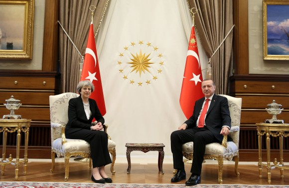 Turkey's President Recep Tayyip Erdogan, right, poses for the photographers with British Prime Minister Theresa May, prior to their meeting at the Presidential Palace in Ankara, Turkey on Jan. 28, 2017. (Pool via AP)