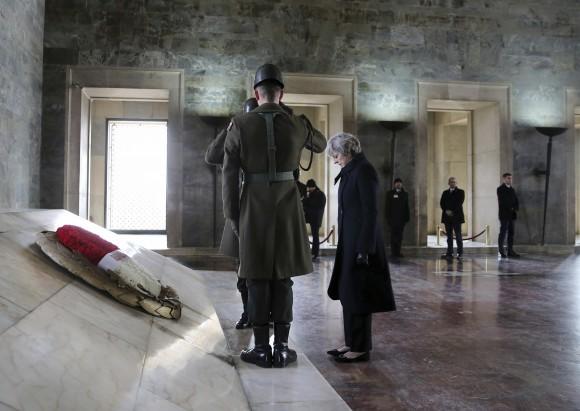 British Prime Minister, Theresa May, stands after laying a wreath at the mausoleum of Turkey's founding father Mustafa Kemal Ataturk, in Ankara, Turkey on Jan. 28, 2017. (Rasit Aydogan/Pool via AP)