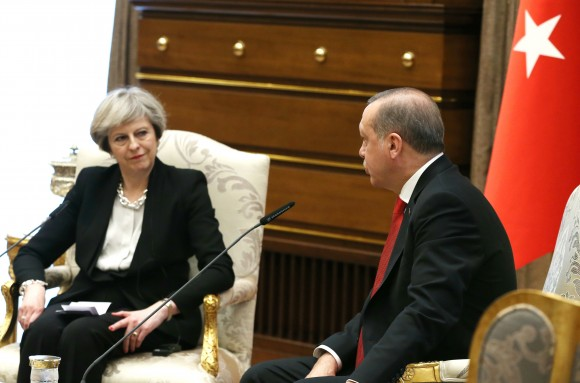 Turkey's President Recep Tayyip Erdogan, right, talks with British Prime Minister Theresa May, during their meeting at the Presidential Palace in Ankara, Turkey, Saturday, Jan. 28, 2017. May on Saturday met with Erdogan, a day after a friendly meeting in Washington with U.S. President Donald Trump. (Presidential Press Service, Pool via AP)