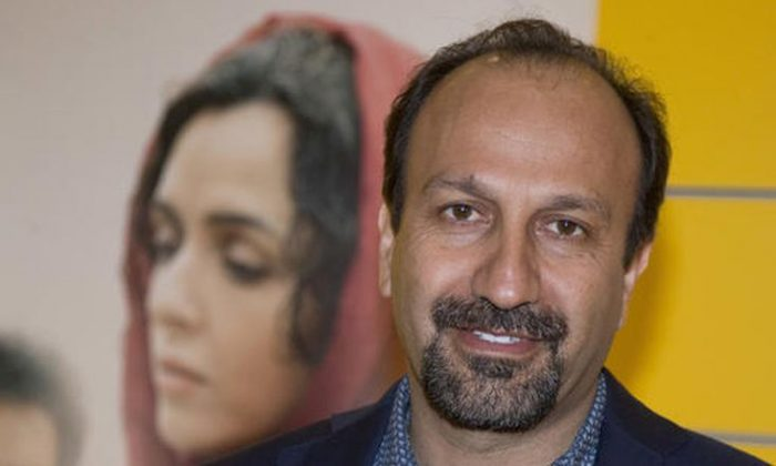 """FILE - In this Oct. 10, 2016 file photo, Iranian director Asghar Farhadi poses for a photo during the premiere of his film, """"The Salesman, in Paris. The motion picture academy calls """"extremely troubling,"""" the possible visa ban of Iranian director Farhadi, whose feature film """"The Salesman"""" is nominated for a best foreign language Oscar. In a statement released Saturday, Jan. 28, 2017, the Academy of Motion Picture Arts and Sciences expressed concern that Farhadi and his cast and crew may not be permitted to attend next month's Oscar ceremony in Los Angeles following President Trump's plan to temporarily suspend issuing visas for people from Iran and six other Muslim countries. (AP Photo/Michel Euler, File)"""