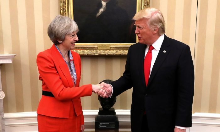 British Prime Minister Theresa May shakes hands with U.S. President Donald Trump in The Oval Office at The White House on January 27, 2017 in Washington, DC. British Prime Minister Theresa May is on a two-day visit to the United States and will be the first world leader to meet with President Donald Trump. (Christopher Furlong/Getty Images)