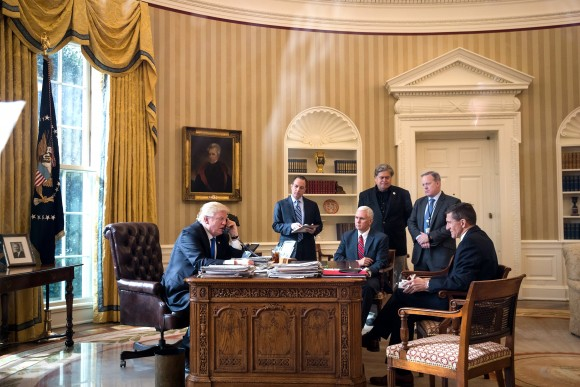 President Donald Trump speaks on the phone with Russian President Vladimir Putin in the Oval Office of the White House in Washington, DC, on Jan. 28, 2017. Also pictured, from left, White House Chief of Staff Reince Priebus, Vice President Mike Pence, White House Chief Strategist Steve Bannon, Press Secretary Sean Spicer and National Security Advisor Michael Flynn. On Saturday, President Trump is making several phone calls with world leaders from Japan, Germany, Russia, France and Australia. (Drew Angerer/Getty Images)
