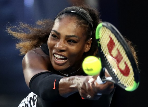 United States' Serena Williams makes a backhand return to her sister Venus during the women's singles final at the Australian Open tennis championships in Melbourne, Australia, on Jan. 28, 2017. (AP Photo/Aaron Favila)