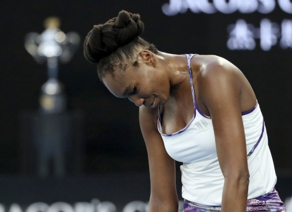 United States' Venus Williams reacts after losing a point to her sister Serena during the women's singles final at the Australian Open tennis championships in Melbourne, Australia, on Jan. 28, 2017. (AP Photo/Aaron Favila)