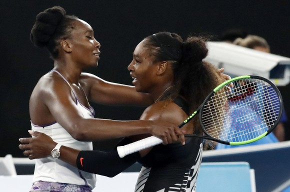 United States' Serena Williams, right, and her sister Venus, left, embrace after Serena won the women's singles final at the Australian Open tennis championships in Melbourne, Australia, on Jan. 28, 2017. (AP Photo/Kin Cheung)