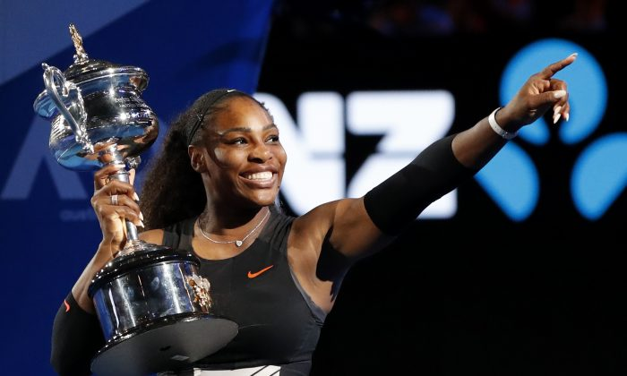 United States' Serena Williams holds her trophy after defeating her sister Venus during the women's singles final at the Australian Open tennis championships in Melbourne, Australia, on Jan. 28, 2017. (AP Photo/Dita Alangkara)