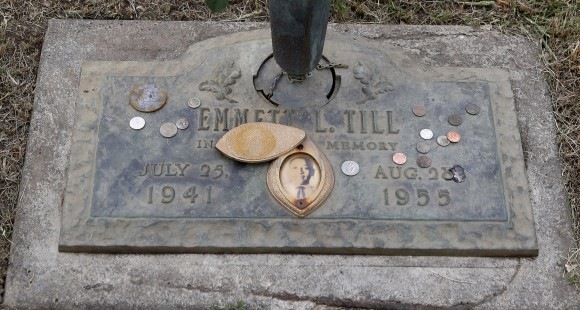 In this file photo, the grave marker of Emmett Till has a photo of Till and coins placed on it during a gravesite ceremony at the Burr Oak Cemetery marking the 60th anniversary of the murder of Till in Mississippi, in Alsip, Ill., on Aug. 28, 2015. (AP Photo/Charles Rex Arbogast)