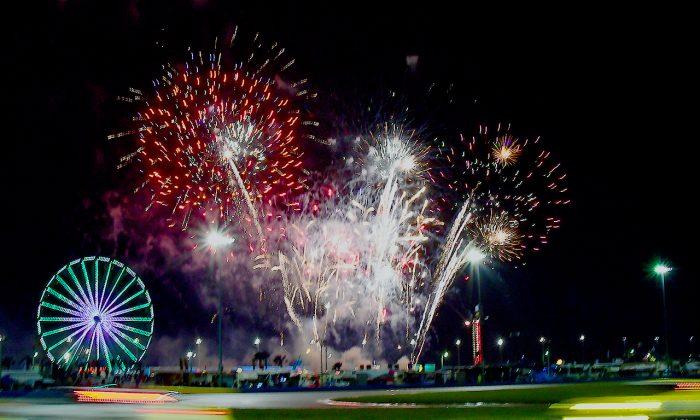 The rain couldn't extinguish the fireworks exploding over Daytona International Speedway Saturday night, Jan 28, 2017, during the Rolex 24 at Daytona. (Bill Kent/Epoch Times)