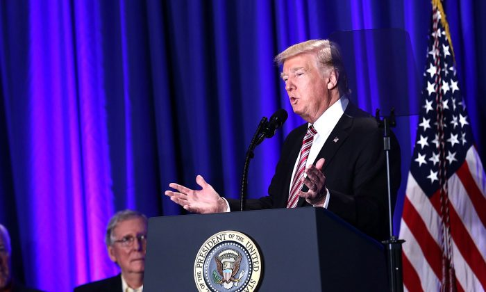 President Donald Trump speaks as Senate Majority Leader Sen. Mitch McConnell (R-KY) looks on during a luncheon at the Congress of Tomorrow Republican Member Retreat in Philadelphia, Pennsylvania on Jan. 26, 2017. (Bill Clark-Pool/Getty Images)