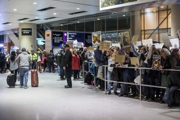 Passengers arrives during a demonstration against the new ban on immigration issued by President Donald Trump at Logan International Airport in Boston, Massachusetts on Jan. 28, 2017. President Trump signed an executive order that halted refugees and residents from predominantly Muslim countries from entering the United States. (Scott Eisen/Getty Images)